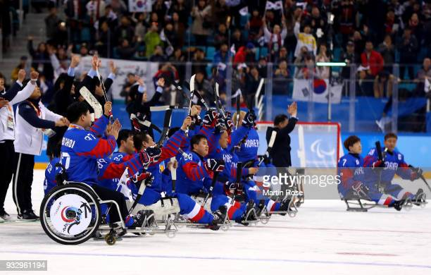 of Korea battles for the puck with of Italy in the Ice Hockey bronze medal game between Korea and Italy during day eight of the PyeongChang 2018...