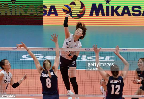 of Korea in action against AUREN GIBBEMEYER and KELLY MURPHY of USA during FIVB Volleyball Nations League match between South Korea and USA at the...