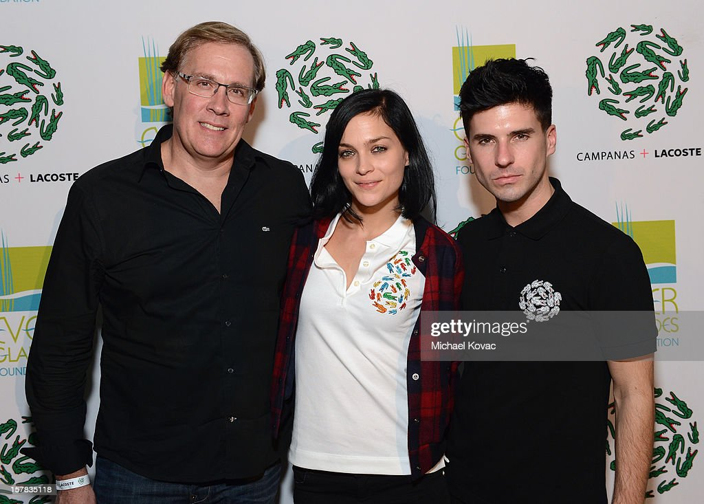 CEO of Lacoste USA Steve Birkhold (L) and musicians Leigh Lezark and Greg Krelenstein attend a LACOSTE + CAMPANAS Celebration during Art Basel Miami Beach at Soho Beach House on December 6, 2012 in Miami Beach, Florida.