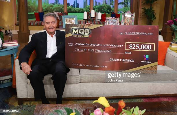 Of Latin GRAMMY Cultural Foundation Manolo Diaz receives check from Mira Quien Baila Winner Greeicy Rendon for Latin GRAMMY Cultural Foundation on...