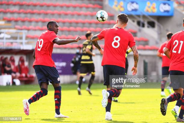 XEKA of Lille celebrates his goal with Isaac LIHADJI of Lille during the preseason soccer friendly match between Lille and Mouscron on July 18 2020...