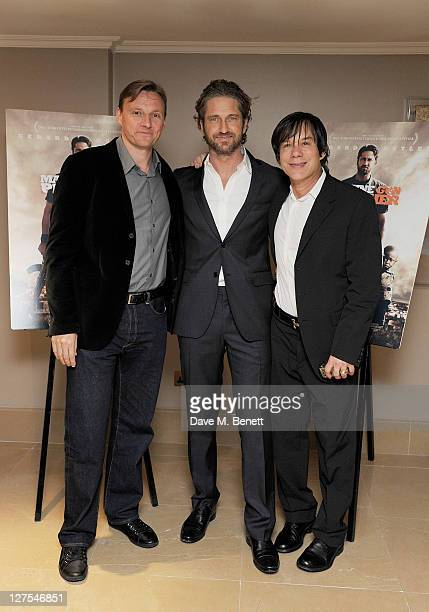 CEO of Lionsgate Zygi Kamasa actor Gerard Butler and manager Alan Siegel attend the UK Premiere of 'Machine Gun Preacher' on September 28 2011 in...