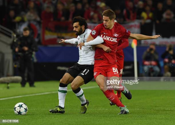 of Liverpool competes with Mario Pasalic of Spartak Moskva during the UEFA Champions League group E match between Spartak Moskva and Liverpool FC at...