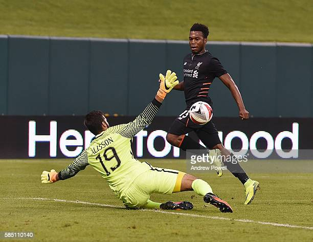 of Liverpool tries to chip Alisson Becker of AS Roma during the friendly match between AS Roma and Liverpool and at Busch Stadium on August 1 2016 in...