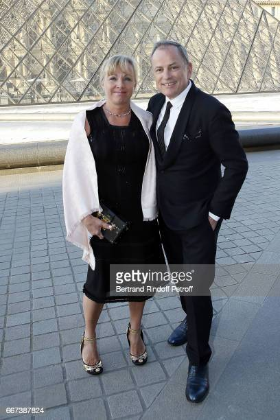 PDG of Louis Vuitton Michael Burke and his wife Brigitte Burke attend the LVxKOONS exhibition at Musee du Louvre on April 11 2017 in Paris France