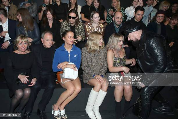 Of Louis Vuitton Michael Burke with his wife Brigitte Burke, Alicia Vikander, Lea Seydoux, Florence Pugh and Peter Marino attend the Louis Vuitton...
