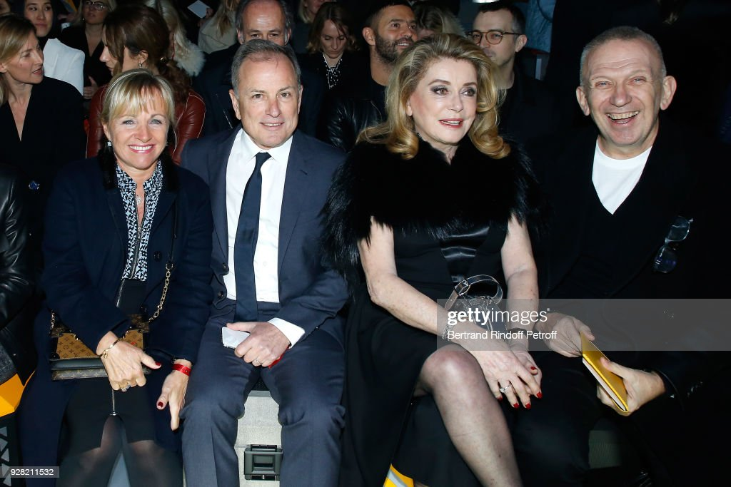 CEO of Louis Vuitton Michael Burke with his wife Brigitte Burke, Catherine Deneuve and Jean-Paul Gaultier attend the Louis Vuitton show as part of the Paris Fashion Week Womenswear Fall/Winter 2018/2019 on March 6, 2018 in Paris, France.
