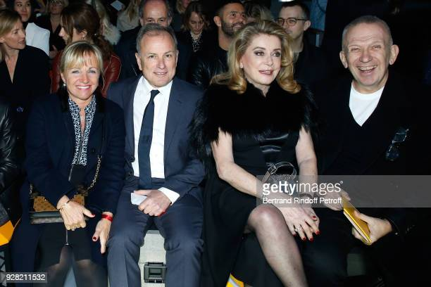 CEO of Louis Vuitton Michael Burke with his wife Brigitte Burke Catherine Deneuve and JeanPaul Gaultier attend the Louis Vuitton show as part of the...