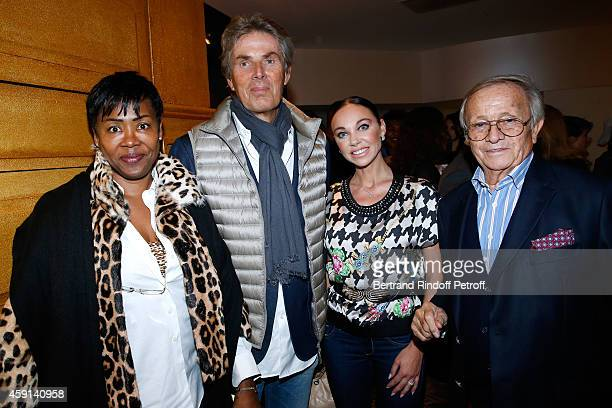 CEO of Lucien Barriere Group Dominique Desseigne and Alexandra Cardinale standing between Prince Jean Poniatowski and Dolores Guibert attend the...