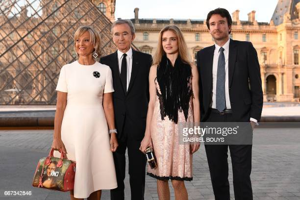 CEO of LVMH Bernard Arnault his wife French pianist Helene MercierArnault their son French businessman Antoine Arnault and his wife Russian model...