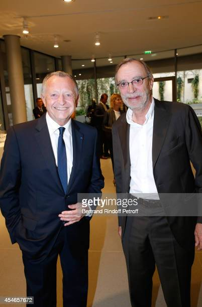 CEO of Lyon Football Club JeanMichel Aulas and CEO of Lille Football Club Michel Seydoux attend the 'Jerome Seydoux Pathe Foundation' Opening party...