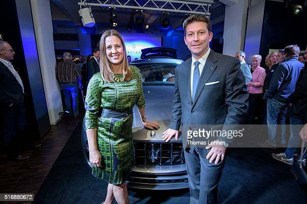 CEO of Maserati Europa Giulio Pastore and Dana Schweiger pictured with the new Maserati Levante at 'Klassikstadt' on March 21 2016 in Frankfurt am...