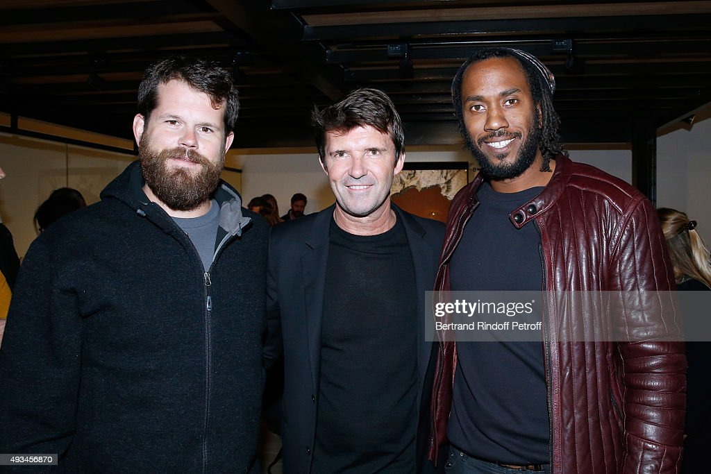 CEO of Mazarine Group and Founder of 'Studio des Acacias' Paul-Emmanuel Reiffers standing between Artists Matthew Day Jackson (L) and Rashid Johnson (R) attend the 'New American Art', Exhibition of Artists Matthew Day Jackson and Rashid Johnson, Opening Cocktail at Studio des Acacias on October 20, 2015 in Paris, France.