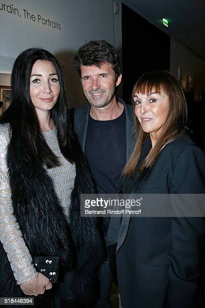 CEO of Mazarine Group and Founder of 'Studio des Acacias' PaulEmmanuel Reiffers standing between his wife Margaux and Babeth Djian attend the 'Guy...