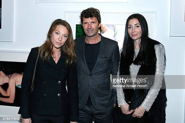 CEO of Mazarine Group and Founder of 'Studio des Acacias' PaulEmmanuel Reiffers standing between his wife Margaux and actress Laura Smet attend the...