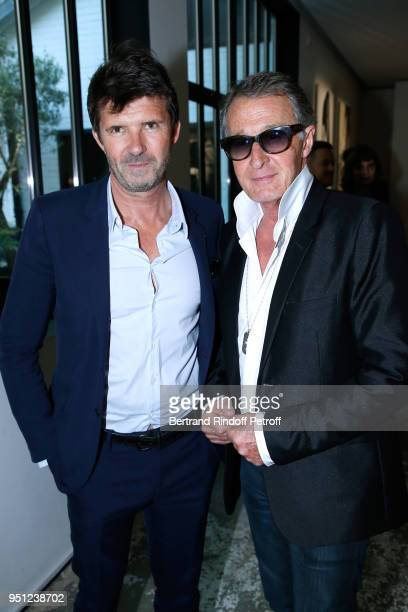 CEO of Mazarine Group PaulEmmanuel Reiffers and Eric Pfrunder attend the Cocktail Party for the MarieAgnes Gillot by Koto Bolofo for Numero Magazine...