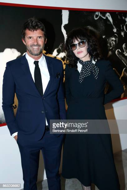 CEO of Mazarine Group PaulEmmanuel Reiffers and Isabelle Adjani attend the Art Exhibition Reflexion Redux of Benjamin Millepied and Barbara Kruger at...