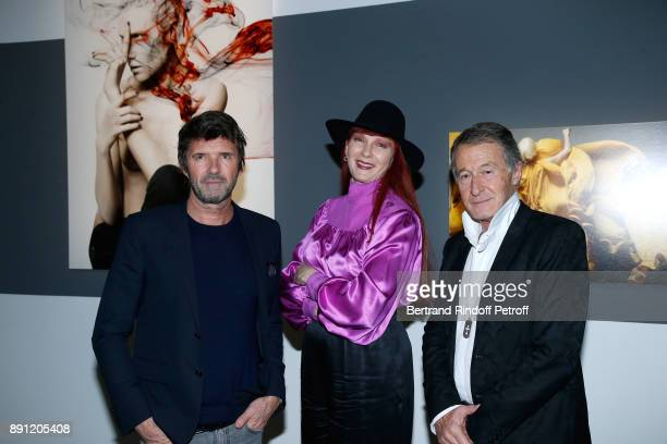 CEO of Mazarine Group PaulEmmanuel Reiffers Betony Vernon and Eric Pfrunder attend the Solve Sundsbo pour Numero Exhibition Opening at Studio des...