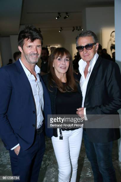 CEO of Mazarine Group PaulEmmanuel Reiffers Creator of the 'Numero magazine' Babeth Djian and Eric Pfrunder attend the Cocktail Party for the...