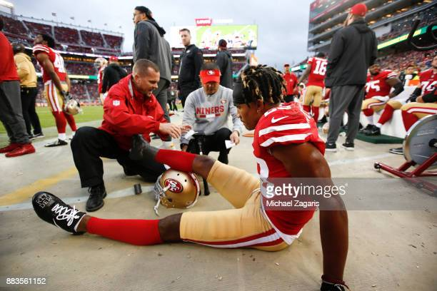 VP of Medical Services and Head Athletic Trainer Jeff Ferguson of the San Francisco 49ers checks on Ahkello Witherspoon on the sideline during the...