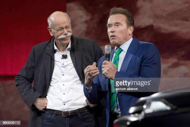 CEO of Mercedes Dieter Zetsche and Arnold Schwarzenegger jointly present the new Gclass at the Michigan Theatre of Detroit US 15 January 2018 The...