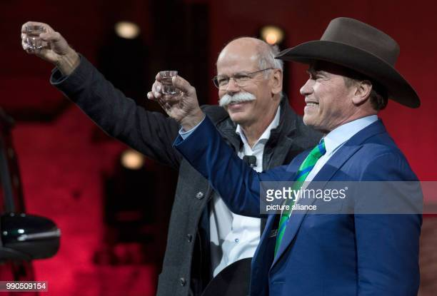 CEO of Mercedes Dieter Zetsche and Arnold Schwarzenegger jointly present the new Gclass at the Michigan Theatre of Detroit US 14 January 2018 The...