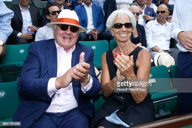 CEO of Moet Hennessy Christophe Navarre and IMF Managing Director Christine Lagarde attend the 2017 French Tennis Open Day Thirteen at Roland Garros...