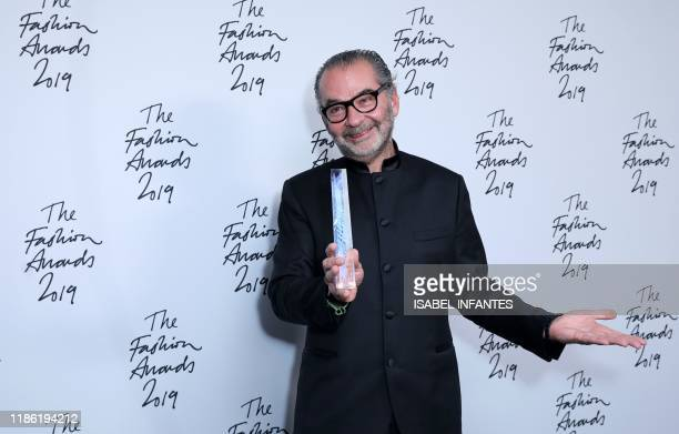 CEO of Moncler Remo Ruffini winner of the Business Leader award poses for a photograph following their award presentation at The Fashion Awards 2019...