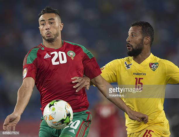 BOUHADDOUZ of Morocco and JACQUES ALAIXYS ROMAO of Togo during the Group C match between Morocco and Togo at Stade Oyem on January 20 2017 in Oyem...