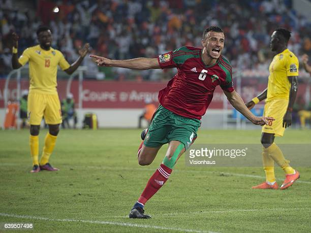 SAISS of Morocco celebrates scoring during the Group C match between Morocco and Togo at Stade Oyem on January 20 2017 in Oyem Gabon