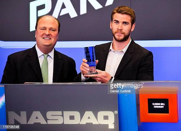 VP of Nasdaq David Wicks and Actor Liam Hemsworth ring the NASDAQ closing bell at NASDAQ MarketSite on August 6 2013 in New York City