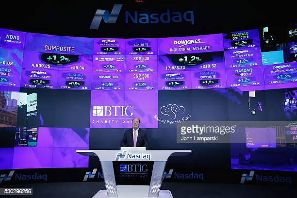 VP of NASDAQ David Wicks BTIG and Petra Nemcova ring Nasdaq Closing Bell for Charity Day at NASDAQ on May 10 2016 in New York City