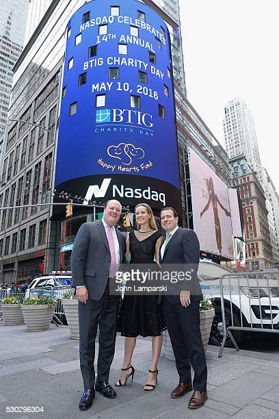 VP of NASDAQ David Wicks Petra Nemcova and BTIG Managing Director Peter Terran ring Nasdaq Closing Bell for Charity Day at NASDAQ on May 10 2016 in...