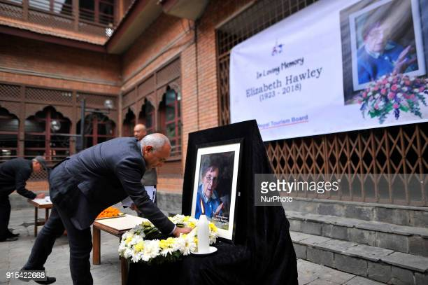 CEO of Nepal Tourism Board Deepak Raj Joshi offering flower towards poster of Legendary Elizabeth Hawley during the condolence meeting at Nepal...