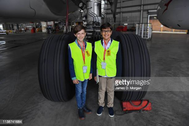 CEO of new airline Oceania Express Alex Jacquot stands next to one set of the wheels of a Qantas A380 aircraft with his Deputy CEO Wolf Stringer as...