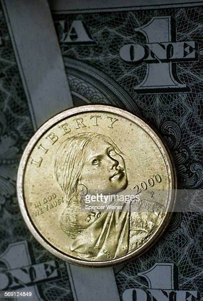 DETAIL of new US Golden Dollar coin The new dollar coin has the image of Sacagawea a Shoshone Indian who assisted the historic Lewis and Clark...