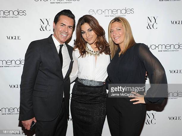 CEO of New York Company Greg Scott and Director of Public Relations NY Co Marielle Gelber pose for a photo with actress Eva Mendes at the Eva Mendes...