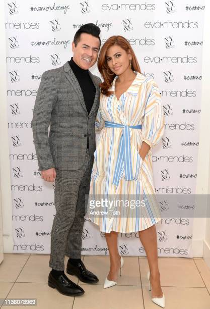 CEO of New York Company Greg Scott poses with Eva Mendes as she visits New York Company Store on March 15 2019 in Burbank California