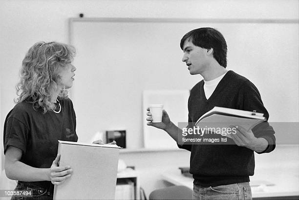 CEO of NeXT Steve Jobs and Susan Kare Creative Director at a meeting in Palo Alto December 1986
