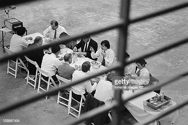 CEO of NeXT Steve Jobs and the NeXT Board of Directors have a meeting in the unfinished factory in Fremont CA in June 1987 Investor Ross Perot sits...