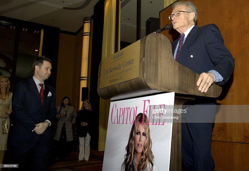 CEO Of Niche Media Jason Binn Looks On As Talk Show Host Larry King