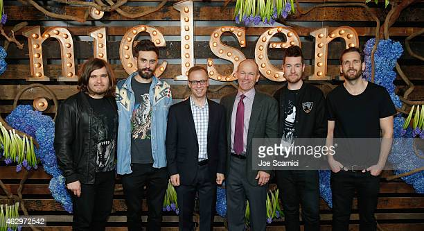 CEO of Nielsen Mitch Barns and Executive Chairman of Nielsen Dave Calhoun with Chris Wood Kyle Simmons Dan Smith and Will Farquarson of Bastille...