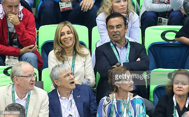 CEO of Nissan and CEO of Renault Carlos Ghosn and his wife Carole Ghosn attend the swimming finals on day 8 of the Rio 2016 Olympic Games at Olympic...