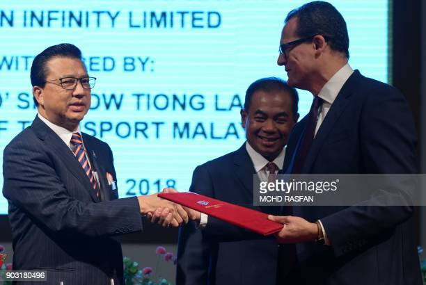 CEO of Ocean Infinity Limited Oliver Plunkett shakes hands with Malaysia's Transport Minister Liow Tiong Lai after a signing ceremony to resume the...