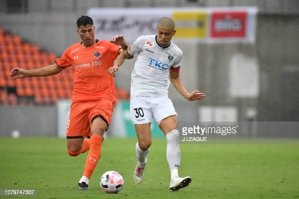 Of Omiya Ardija and Masaya TASHIRO of Tochigi SC battle for the ball during the J.League Meiji Yasuda J2 match between Omiya Ardija and Tochigi SC at...