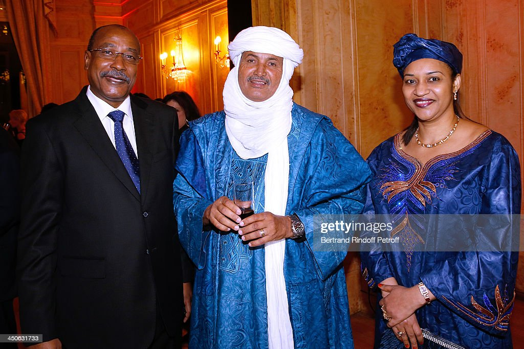 CEO of O.N.G. 'Tidene' Mohamed Ixa standing between Ambassador of Niger Abderahamane Assane Mayaki and his wife attend 'Les Puits du Desert' Charity Gala at Cercle des Armees on November 19, 2013 in Paris, France.