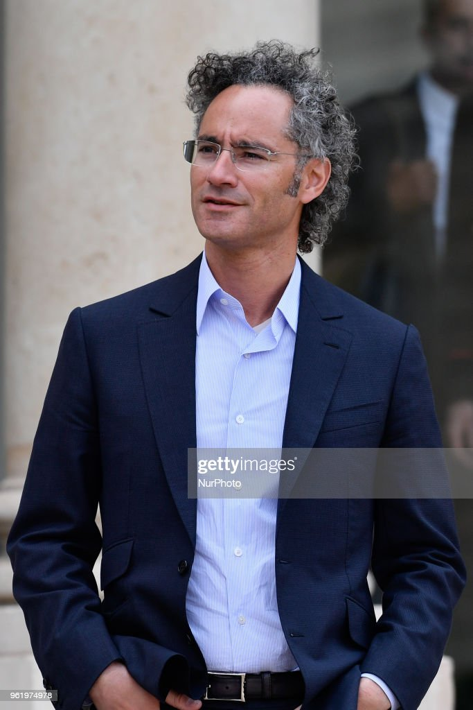 CEO of Palantir Alex Karp speaks to the press as he leaves