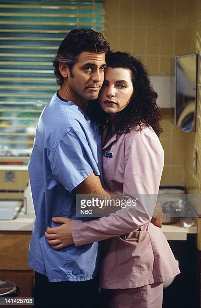 ER 'Of Past Regret and Future Fear' Episode 20 Air Date Pictured George Clooney as Doctor Doug Ross Julianna Margulies as Nurse Carol Hathaway Photo...