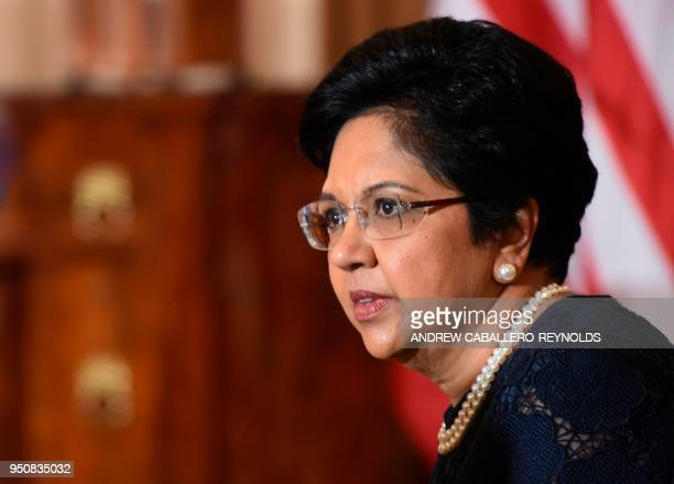 CEO of Pepsi Indra Nooyi looks on before a luncheon with French President Emmanuel Macron and US Vice President Mike Pence at the US State Department...