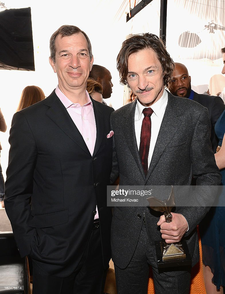 CEO of Piaget Philippe Leopold-Metzger and actor John Hawkes pose in the Piaget Lounge during The 2013 Film Independent Spirit Awards on February 23, 2013 in Santa Monica, California.